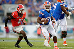 Florida Gators quarterback Treon Harris keeps the ball and sprints upfield on third and long to get the first down in the second half, as the Gators spook the Georgia Bulldogs with a 27-3 win at EverBank Field.  October 31st, 2015. Gator Country photo by David Bowie.