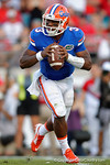 Florida Gators quarterback Treon Harris scrambles out of the pocket looking downfield during the second half, as the Gators spook the Georgia Bulldogs with a 27-3 win at EverBank Field.  October 31st, 2015. Gator Country photo by David Bowie.