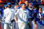 Florida Gators head coach Jim McElwain running down the sideline shouting directions during the first half, as the Gators spook the Georgia Bulldogs with a 27-3 win at EverBank Field.  October 31st, 2015. Gator Country photo by David Bowie.