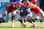 Florida Gators quarterback Treon Harris is sandwiched as Georgia defenders James DeLoach and Davin Bellamy combine for a sack during the first half, as the Gators spook the Georgia Bulldogs with a 27-3 win at EverBank Field.  October 31st, 2015. Gator Country photo by David Bowie.