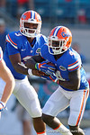 Florida Gators quarterback Treon Harris hands the ball of to Florida Gators running back Brandon Powell during the first half as the Gators spook the Georgia Bulldogs with a 27-3 win at EverBank Field.  October 31st, 2015. Gator Country photo by David Bowie.