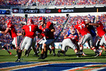 Georgia Bulldogs quarterback Faton Bauta turns and hands off the back while in their own endzone in the first half, as the Gators spook the Georgia Bulldogs with a 27-3 win at EverBank Field.  October 31st, 2015. Gator Country photo by David Bowie.