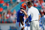 Florida Gators offensive coordinator and quarterbacks coach Doug Nussmeier coaches up Florida Gators quarterback Treon Harris during pre-game drills as the Gators spook the Georgia Bulldogs with a 27-3 win at EverBank Field.  October 31st, 2015. Gator Country photo by David Bowie.