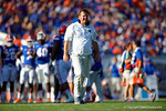 Florida Gators head coach Jim McElwain walking onto the field to check on an injured player during the first half, as the Gators spook the Georgia Bulldogs with a 27-3 win at EverBank Field.  October 31st, 2015. Gator Country photo by David Bowie.