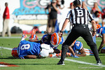 Georgia Bulldogs WR Reggioe Davis fumbles a punt which Florida Gators defensive back Nick Washinton falls on in the endzone to give the Gators a 6-0 lead in the first half, as the Gators spook the Georgia Bulldogs with a 27-3 win at EverBank Field.  October 31st, 2015. Gator Country photo by David Bowie.