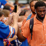 Florida Gators defensive back Brian Poole and the University of Florida Gators march into the stadium as Gator fans cheer them on during the first Gator Walk of the season.  September 5th, 2015.  Gator Country Photo by David Bowie.