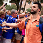 Florida Gators quarterback Will Grier and the University of Florida Gators march into the stadium as Gator fans cheer them on during the first Gator Walk of the season.  September 5th, 2015.  Gator Country Photo by David Bowie.