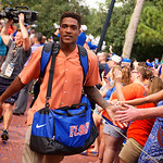Florida Gators wide receiver Demarcus Robinson and the University of Florida Gators march into the stadium as Gator fans cheer them on during the first Gator Walk of the season.  September 5th, 2015.  Gator Country Photo by David Bowie.