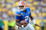 Florida Gators quarterback Treon Harris rolls out during the first half as the Univeristy of Florida Gators and the University of Michigan Wolverines square off in the 2016 Buffalo Wild Wings Citrus Bowl.  Orlando, Fl.  January 1st, 2015. Gator Country photo by David Bowie.