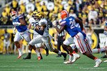 Michigan wide receiver Jehu Chesson takes off downfield during the first half as the Univeristy of Florida Gators and the University of Michigan Wolverines square off in the 2016 Buffalo Wild Wings Citrus Bowl.  Orlando, Fl.  January 1st, 2015. Gator Country photo by David Bowie.