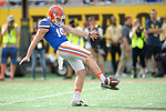 Florida Gators punter Johnny Townsend punting during the second half as the Univeristy of Florida Gators and the University of Michigan Wolverines square off in the 2016 Buffalo Wild Wings Citrus Bowl.  Orlando, Fl.  January 1st, 2015. Gator Country photo by David Bowie.