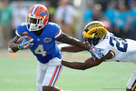 Florida Gators running back Brandon Powell tries to break away from a tackle during the first half as the Univeristy of Florida Gators and the University of Michigan Wolverines square off in the 2016 Buffalo Wild Wings Citrus Bowl.  Orlando, Fl.  January 1st, 2015. Gator Country photo by David Bowie.