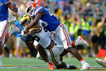 Michigan wide receiver Jehu Chesson is tackled by Florida Gators defensive back Marcus Maye during the first half as the Univeristy of Florida Gators and the University of Michigan Wolverines square off in the 2016 Buffalo Wild Wings Citrus Bowl.  Orlando, Fl.  January 1st, 2015. Gator Country photo by David Bowie.