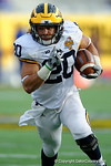Michigan running back Drake Johnson rushing during the second half as the Univeristy of Florida Gators and the University of Michigan Wolverines square off in the 2016 Buffalo Wild Wings Citrus Bowl.  Orlando, Fl.  January 1st, 2015. Gator Country photo by David Bowie.