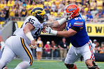 Florida Gators offensive lineman Trip Thurman and Michigan defensive lineman Chase Winovich battle in the trenches during the first half as the Univeristy of Florida Gators and the University of Michigan Wolverines square off in the 2016 Buffalo Wild Wings Citrus Bowl.  Orlando, Fl.  January 1st, 2015. Gator Country photo by David Bowie.