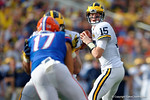 Michigan quarterback Jake Rudock looks downfield during the second half as the Univeristy of Florida Gators and the University of Michigan Wolverines square off in the 2016 Buffalo Wild Wings Citrus Bowl.  Orlando, Fl.  January 1st, 2015. Gator Country photo by David Bowie.
