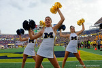 A beautiful Michigan Wolverines cheerleader dances for the fans during the second half as the Univeristy of Florida Gators and the University of Michigan Wolverines square off in the 2016 Buffalo Wild Wings Citrus Bowl.  Orlando, Fl.  January 1st, 2015. Gator Country photo by David Bowie.