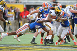 Florida Gators defensive back Keanu Neal diving to make a tackle during the second half as the Univeristy of Florida Gators and the University of Michigan Wolverines square off in the 2016 Buffalo Wild Wings Citrus Bowl.  Orlando, Fl.  January 1st, 2015. Gator Country photo by David Bowie.