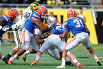 Florida Gators defensive lineman Jonathan Bullard with a tackle during the first half as the Univeristy of Florida Gators and the University of Michigan Wolverines square off in the 2016 Buffalo Wild Wings Citrus Bowl.  Orlando, Fl.  January 1st, 2015. Gator Country photo by David Bowie.