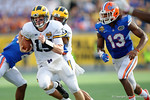 Michigan quarterback Jake Rudock scambling during the second half as the Univeristy of Florida Gators and the University of Michigan Wolverines square off in the 2016 Buffalo Wild Wings Citrus Bowl.  Orlando, Fl.  January 1st, 2015. Gator Country photo by David Bowie.