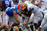 Florida Gators defensive lineman Justus Reed makes a hit on Michigan running back  De'Veon Smith during the first half as the Univeristy of Florida Gators and the University of Michigan Wolverines square off in the 2016 Buffalo Wild Wings Citrus Bowl.  Orlando, Fl.  January 1st, 2015. Gator Country photo by David Bowie.