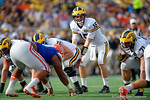 Michigan quarterback Jake Rudock at the line of scrimmage during the second half as the Univeristy of Florida Gators and the University of Michigan Wolverines square off in the 2016 Buffalo Wild Wings Citrus Bowl.  Orlando, Fl.  January 1st, 2015. Gator Country photo by David Bowie.