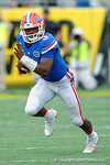 Florida Gators quarterback Treon Harris scrambling during the second half as the Univeristy of Florida Gators and the University of Michigan Wolverines square off in the 2016 Buffalo Wild Wings Citrus Bowl.  Orlando, Fl.  January 1st, 2015. Gator Country photo by David Bowie.