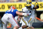 Michigan running back De'Veon Smith rushing during the first half as the Univeristy of Florida Gators and the University of Michigan Wolverines square off in the 2016 Buffalo Wild Wings Citrus Bowl.  Orlando, Fl.  January 1st, 2015. Gator Country photo by David Bowie.