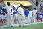 Florida Gators head coach Jim McElwain and Florida Gators defensive line coach Chris Rumph watch on from the sideline during the first half as the Univeristy of Florida Gators and the University of Michigan Wolverines square off in the 2016 Buffalo Wild Wings Citrus Bowl.  Orlando, Fl.  January 1st, 2015. Gator Country photo by David Bowie.