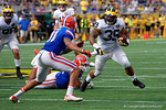 Michigan fullback Sione Houma rushing during the first half as the Univeristy of Florida Gators and the University of Michigan Wolverines square off in the 2016 Buffalo Wild Wings Citrus Bowl.  Orlando, Fl.  January 1st, 2015. Gator Country photo by David Bowie.