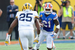 Florida Gators running back Kelvin Taylor rushing during the first half as the Univeristy of Florida Gators and the University of Michigan Wolverines square off in the 2016 Buffalo Wild Wings Citrus Bowl.  Orlando, Fl.  January 1st, 2015. Gator Country photo by David Bowie.