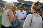Florida Gators head coach Jim McElwain gives out gum to his daughters, a post game ritual for the family, after losing to the University of Michigan Wolverines square off in the 2016 Buffalo Wild Wings Citrus Bowl.  Orlando, Fl.  January 1st, 2015. Gator Country photo by David Bowie.