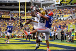 Michigan safety Jarrod Wilson leaps into the air for an interception during the first half as the Univeristy of Florida Gators and the University of Michigan Wolverines square off in the 2016 Buffalo Wild Wings Citrus Bowl.  Orlando, Fl.  January 1st, 2015. Gator Country photo by David Bowie.