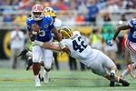 Florida Gators quarterback Treon Harris rushing during the first half as the Univeristy of Florida Gators and the University of Michigan Wolverines square off in the 2016 Buffalo Wild Wings Citrus Bowl.  Orlando, Fl.  January 1st, 2015. Gator Country photo by David Bowie.