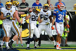 Michigan running back Drake Johnson celebrates following a touchdown during the second half as the Univeristy of Florida Gators and the University of Michigan Wolverines square off in the 2016 Buffalo Wild Wings Citrus Bowl.  Orlando, Fl.  January 1st, 2015. Gator Country photo by David Bowie.