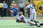 Florida Gators quarterback Treon Harris is tackled during the first half as the Univeristy of Florida Gators and the University of Michigan Wolverines square off in the 2016 Buffalo Wild Wings Citrus Bowl.  Orlando, Fl.  January 1st, 2015. Gator Country photo by David Bowie.