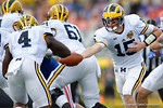 Michigan quarterback Jake Rudock turns to hand the ball off during the first half as the Univeristy of Florida Gators and the University of Michigan Wolverines square off in the 2016 Buffalo Wild Wings Citrus Bowl.  Orlando, Fl.  January 1st, 2015. Gator Country photo by David Bowie.