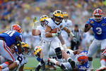 Michigan running back Drake Johnson rushing during the first half as the Univeristy of Florida Gators and the University of Michigan Wolverines square off in the 2016 Buffalo Wild Wings Citrus Bowl.  Orlando, Fl.  January 1st, 2015. Gator Country photo by David Bowie.