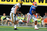 Florida Gators quarterback Treon Harris scrambling during the first half as the Univeristy of Florida Gators and the University of Michigan Wolverines square off in the 2016 Buffalo Wild Wings Citrus Bowl.  Orlando, Fl.  January 1st, 2015. Gator Country photo by David Bowie.