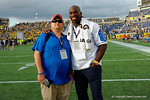 Former Gator Titus O'Neill and Gator Country's Andrew Spivey during the second half as the Univeristy of Florida Gators and the University of Michigan Wolverines square off in the 2016 Buffalo Wild Wings Citrus Bowl.  Orlando, Fl.  January 1st, 2015. Gator Country photo by David Bowie.