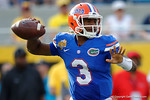 Florida Gators quarterback Treon Harris throwing during the second half as the Univeristy of Florida Gators and the University of Michigan Wolverines square off in the 2016 Buffalo Wild Wings Citrus Bowl.  Orlando, Fl.  January 1st, 2015. Gator Country photo by David Bowie.