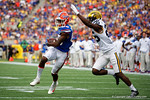 Florida Gators wide receiver Chris Thompson makes a catch, is tackled and the ball comes out, he was called down by contact after replay confirmed it during the first half as the Univeristy of Florida Gators and the University of Michigan Wolverines square off in the 2016 Buffalo Wild Wings Citrus Bowl.  Orlando, Fl.  January 1st, 2015. Gator Country photo by David Bowie.