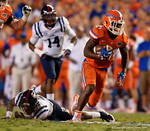Florida Gators running back Kelvin Taylor breaks free from a tackle in the first half, as the Gators knock off the #3 ranked Ole Miss Rebels 38-10 at home.  Florida Gators vs Ole Miss Rebels.  October 3rd, 2015. Gator Country photo by David Bowie.