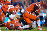 Florida Gators defensive end Alex McCalister and Florida Gators linebacker Jarrad Davis combine for a sack during the first half as the Gators knock off the #3 ranked Ole Miss Rebels 38-10 at home.  Florida Gators vs Ole Miss Rebels.  October 3rd, 2015. Gator Country photo by David Bowie.