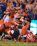 Florida Gators defensive back Vernon Hargreaves, III leaps over a crowd as he returns an interception during the second half, as the Gators knock off the #3 ranked Ole Miss Rebels 38-10 at home.  Florida Gators vs Ole Miss Rebels.  October 3rd, 2015. Gator Country photo by David Bowie.