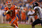 Florida Gators quarterback Will Grier rushes downfield in the second half, as the Gators knock off the #3 ranked Ole Miss Rebels 38-10 at home.  Florida Gators vs Ole Miss Rebels.  October 3rd, 2015. Gator Country photo by David Bowie.