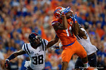 Florida Gators wide receiver Demarcus Robinson leaps into the air for a touchdown to give the Gators a 6-0 lead, as the Gators knock off the #3 ranked Ole Miss Rebels 38-10 at home.  Florida Gators vs Ole Miss Rebels.  October 3rd, 2015. Gator Country photo by David Bowie.