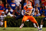 Florida Gators tight end DeAndre Goolsby tries to break free from a tackle in the first half, as the Gators knock off the #3 ranked Ole Miss Rebels 38-10 at home.  Florida Gators vs Ole Miss Rebels.  October 3rd, 2015. Gator Country photo by David Bowie.