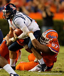 Florida Gators defensive lineman Caleb Brantley sacks Ole Miss quarterback Chad Kelly during the first half, as the Gators knock off the #3 ranked Ole Miss Rebels 38-10 at home.  Florida Gators vs Ole Miss Rebels.  October 3rd, 2015. Gator Country photo by David Bowie.