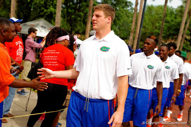 Florida Gators tight end Jake McGee and the Florida Gators march into the stadium for the Orange and Blue Debut during Gator Walk.  2015 Orange and Blue Debut.  April 11th 2015. Gator Country photo by David Bowie.